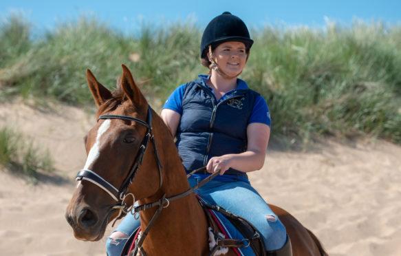 Grace Hardie and her horse on Balmedie Beach