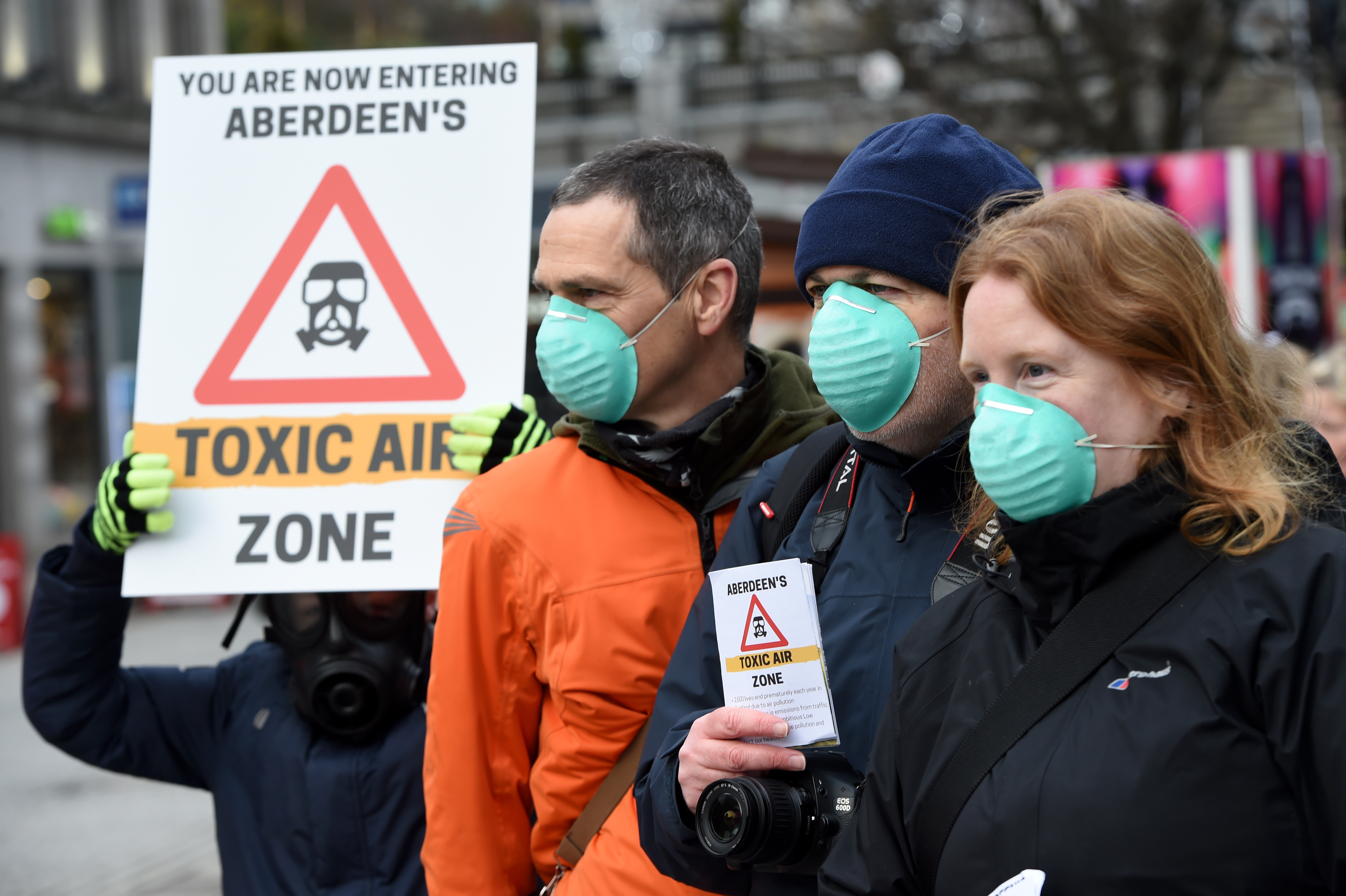Campaingers held signs and wore masks