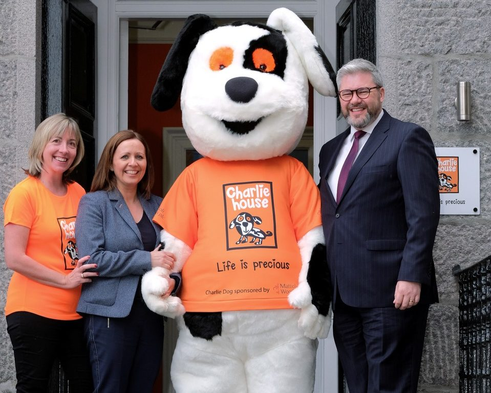 L-R: Susan Crighton, Director of Fundraising at Charlie House, Wendy Atkinson, Aberdeen-based Business Development Manager at Mattioli Woods, Charlie Dog and David Gibson, Senior Consultant at Mattioli Woods celebrate a two-year sponsorship deal which has enabled the purchase of a bespoke mascot for local charity Charlie House.