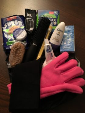 The emergency packs contain toiletries, sanitary products, hats, gloves and basic food supplies such as biscuits and dried noodles, amongst other supplies.