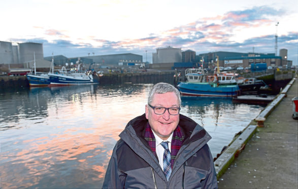 Fisheries Minister Fergus Ewing visited Peterhead Harbour to hear details of the planned expansion of Europe's biggest fishing port.