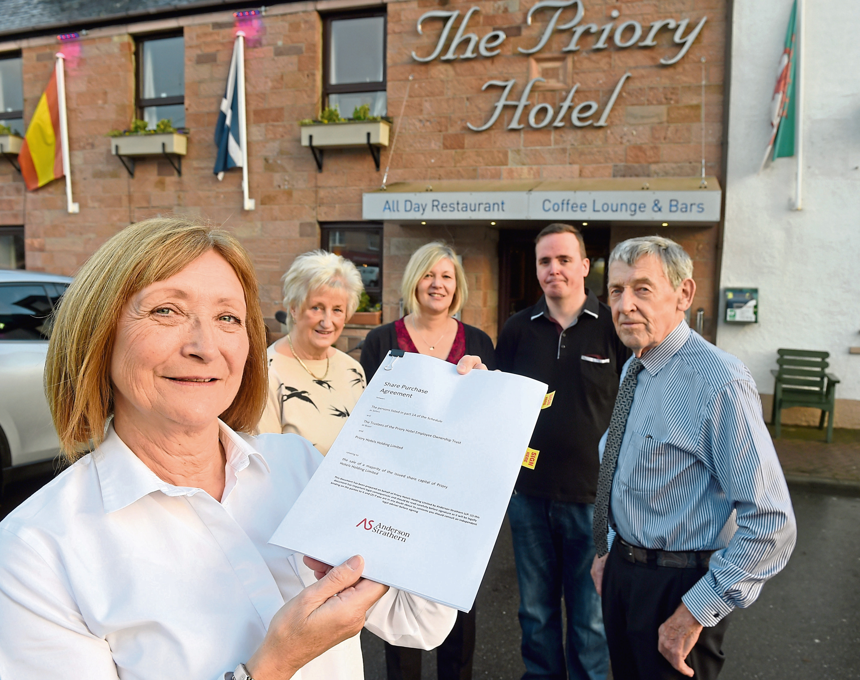 Member of staff, Veronica Finlay (left) with Eveline (second left) and Stuart (right) Hutton while in the centre are fellow employees Barry Wright and Janet Munro.