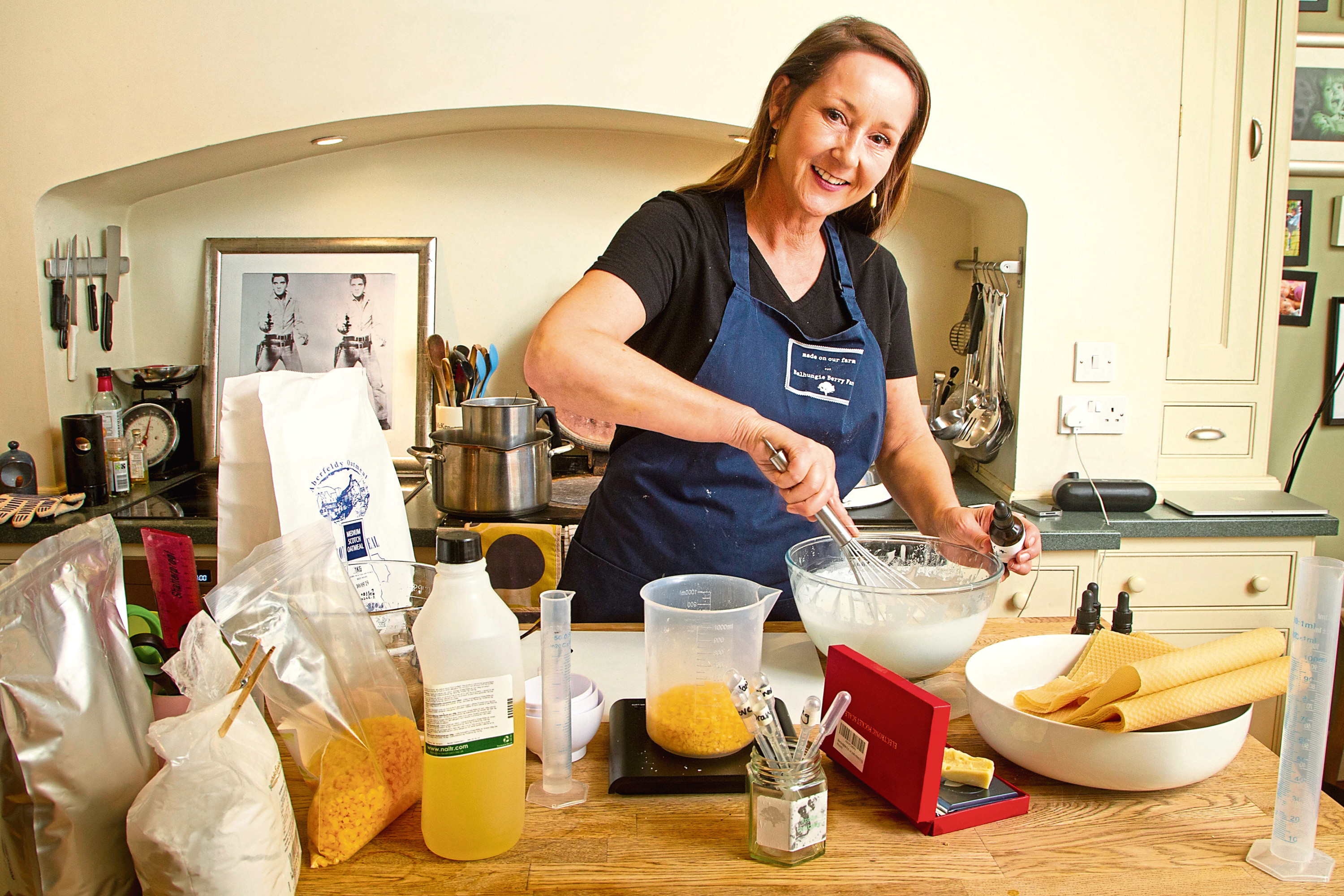 Michelle Porter making products in her kitchen.