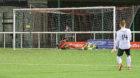 Rabin Omar bundles the ball into the Edinburgh net.