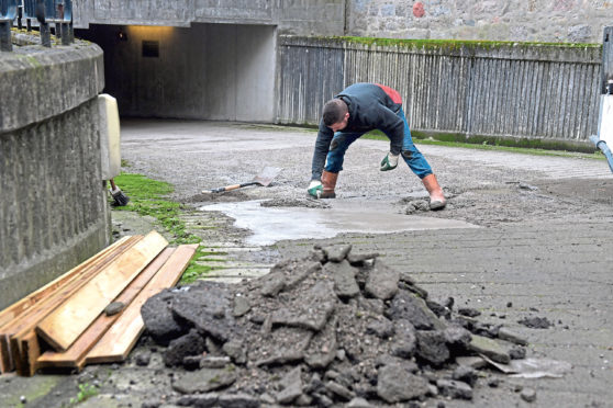 Repair work being carried out on the road surface at the Town House car park entrance.