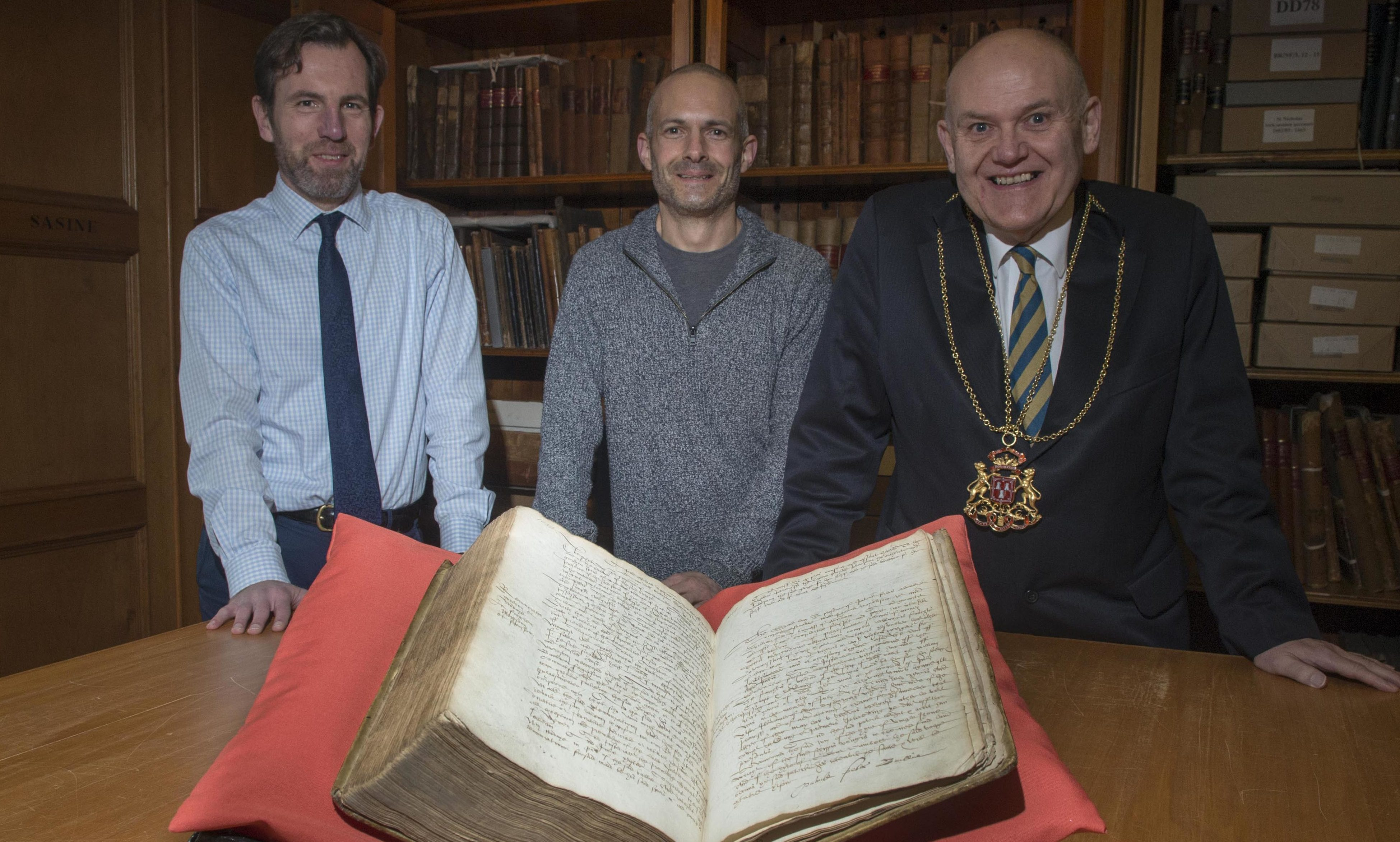 Picture left to right: Phil Astley (Archivist),Thomas Brochard, an Honorary Research Fellow at the University of Aberdeen, Lord Provost Barney Crockett