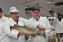 Secretary of State for Scotland David Mundell (right) with Jimmy Buchan and a cod from the Peterhead Fish Market