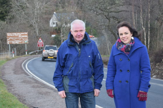Campaigner Douglas Stewart and Kate Forbes MSP on the side of the A82.