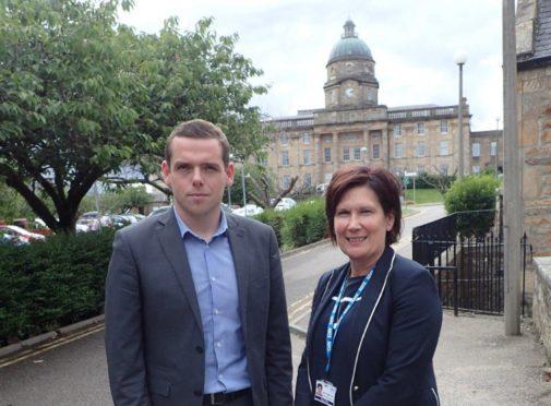 Douglas Ross and Amanda Croft outside Dr Gray's Hospital