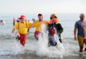 Hundreds took part in the Boxing Day Nippy Dipper at Aberdeen Beach. (Picture by Darrell Benns)