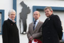 Linda Coe, chairwoman of Grantown and Vicinity Community Council, Roger Grant of the Grantown branch of the Royal British Legion and Ewan MacGregor, also of the community council, next to the Silent Soldier Silhouette.