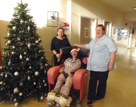 Dee View Court resident Kerry helped put up the centre's tree.