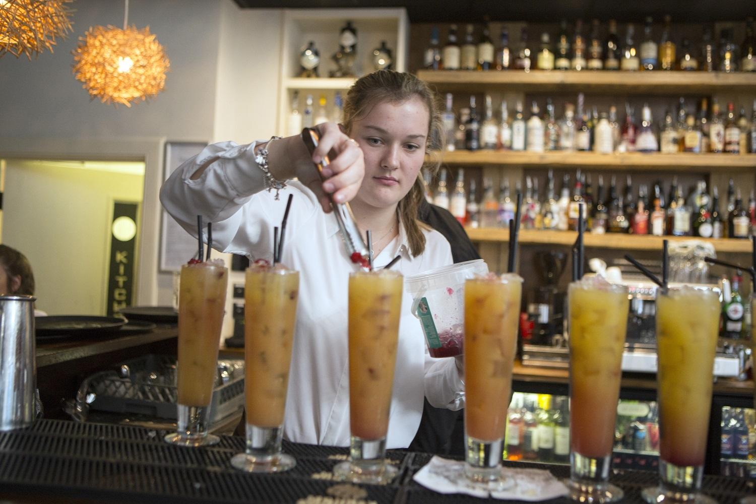 Charleston pupil Kirsty Hay preparing a mocktail at the event hosted in Inverness' The White House