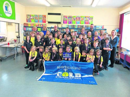 Midmar Primary school kids winning Sportscotland gold award.