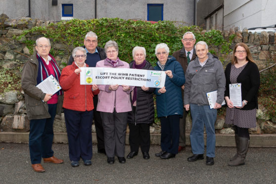 Malcolm Newton, Rhoda Mackay, Donald Macleod, Cathy Taylor, Euna Maciver, Margaret Eaves, D.L. Smith, Murdo Smith and Helen Sandison gather as representatives of the various groups launching the petition.