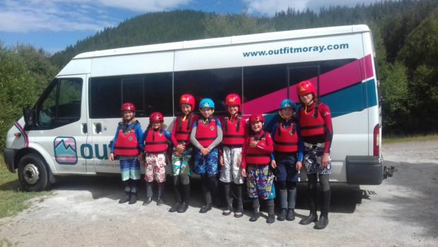 A group of Outfit Moray participants prepare for a kayaking adventure.