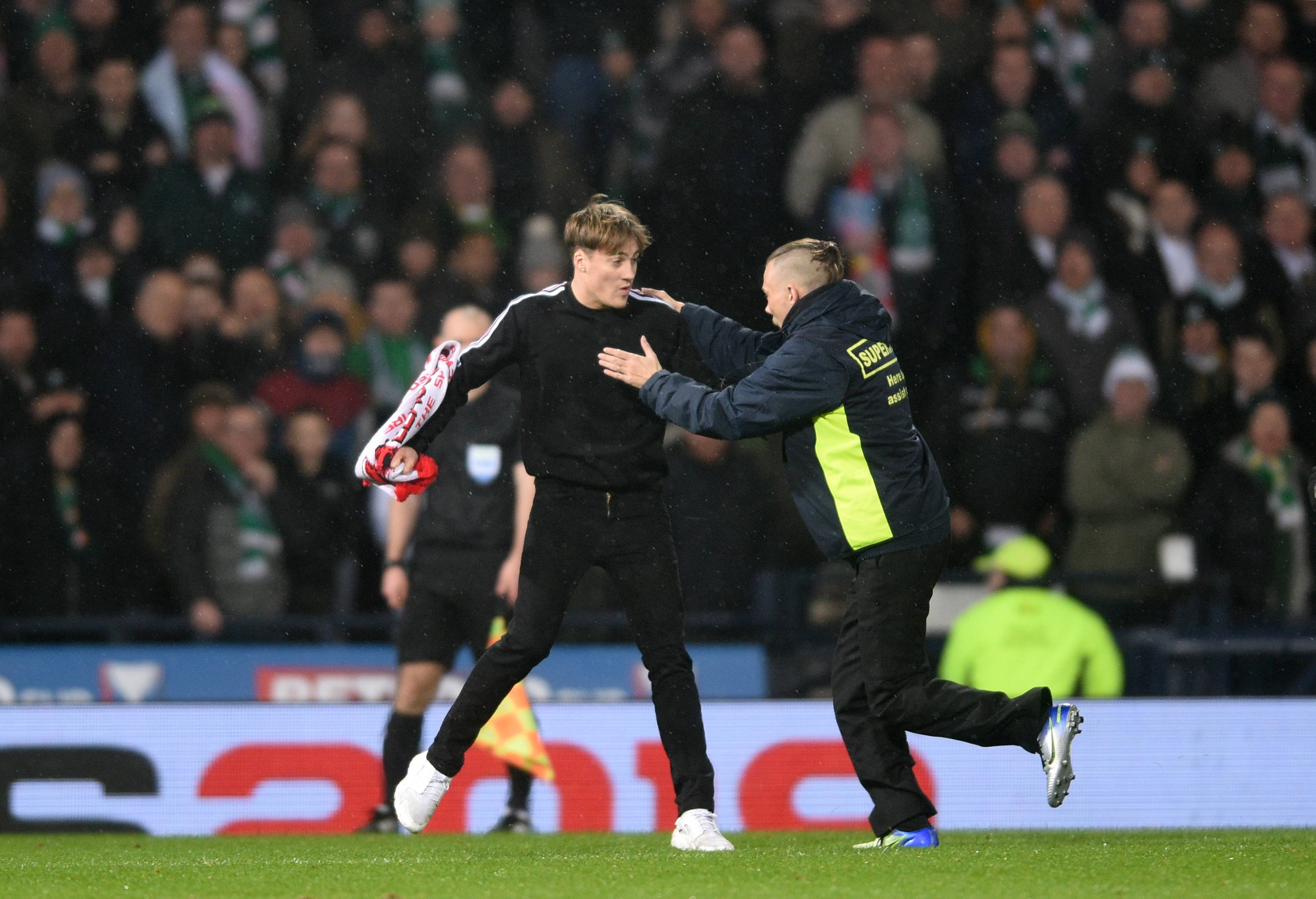 Dons fan Gavin Elpinstone raced onto the pitch at Hampden.