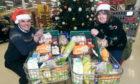 Councillor Geva Blackett has organised three free festive lunches in Deeside.