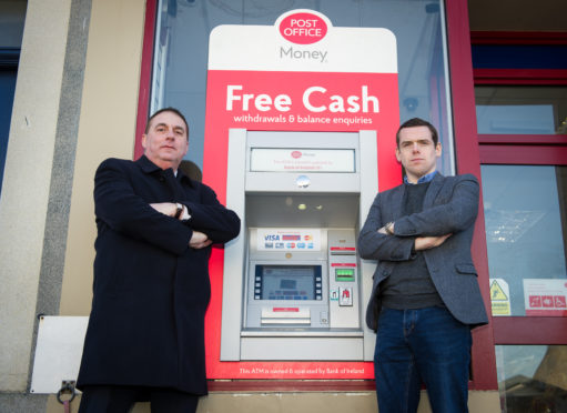 Heldon and Laich councillor James Alland and Moray MP Douglas Ross outside the Post Office ATM in Lossiemouth.