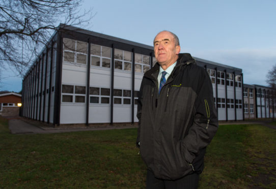 George Alexander outside Forres Academy