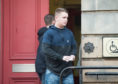 Norman Stewart is pictured leaving Elgin Sheriff Court, Moray today.