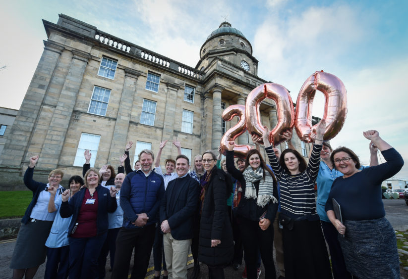 Management and staff are pictured outside Dr. Gray's hospital in Elgin to commemorate its 200th anniversary. Photograph by Jason Hedges.