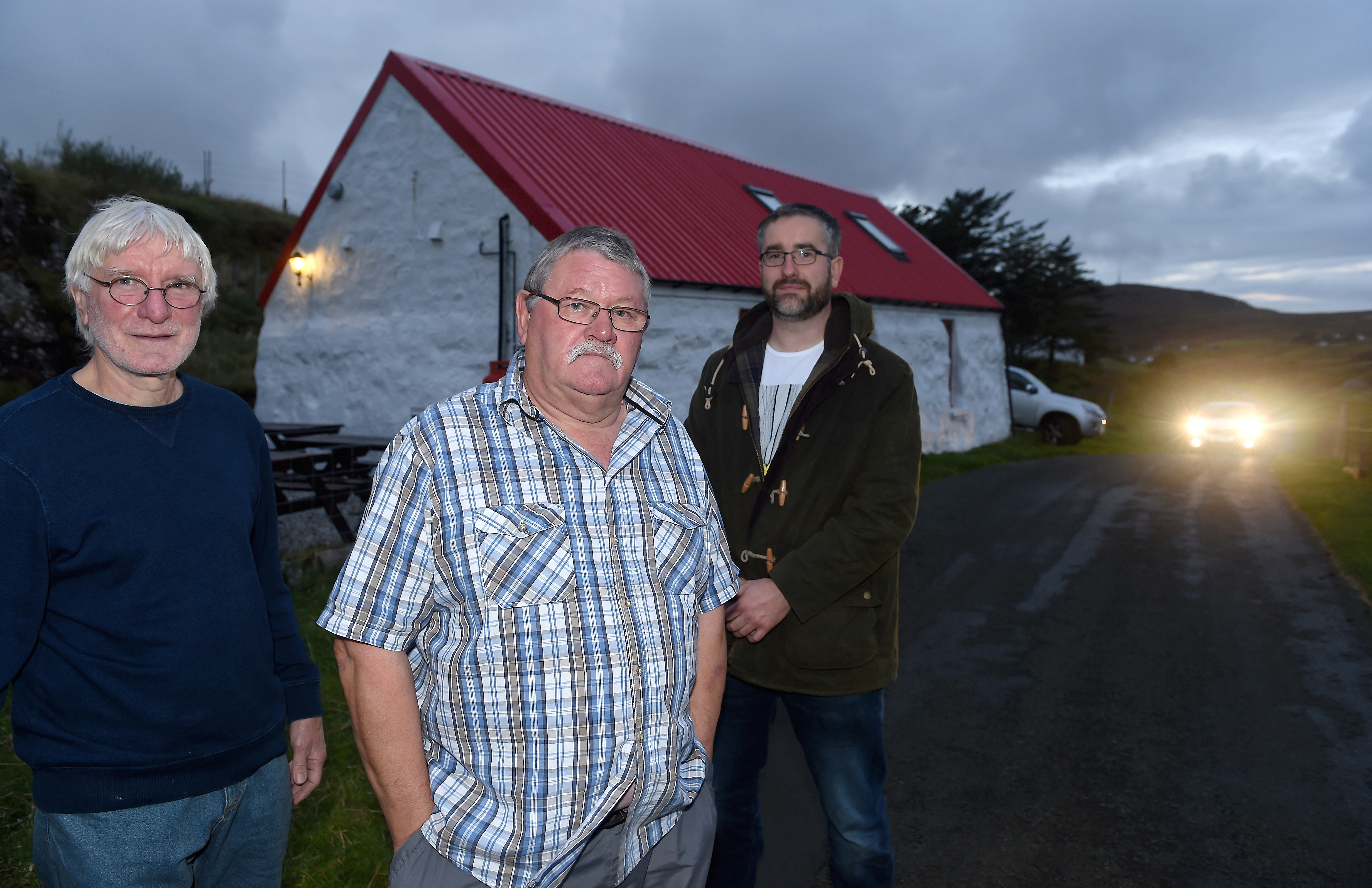 Elgar Finlay (right) with the Vice Chairman of the Glendale Community Council Kevin Stockley (centre) with secretary Donald Murdie.
