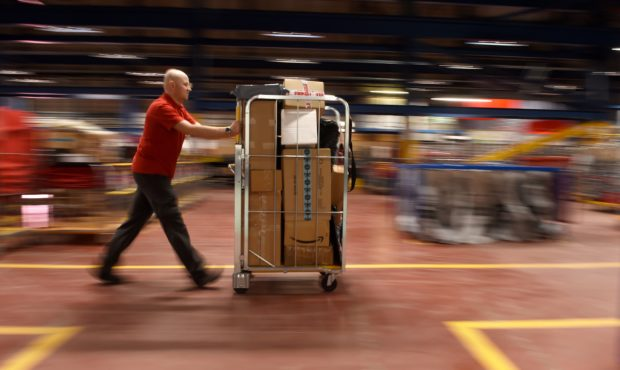 Postal worker Krzysztof Pyrka at work in the busy Inverness Mail Centre. Picture by Sandy McCook