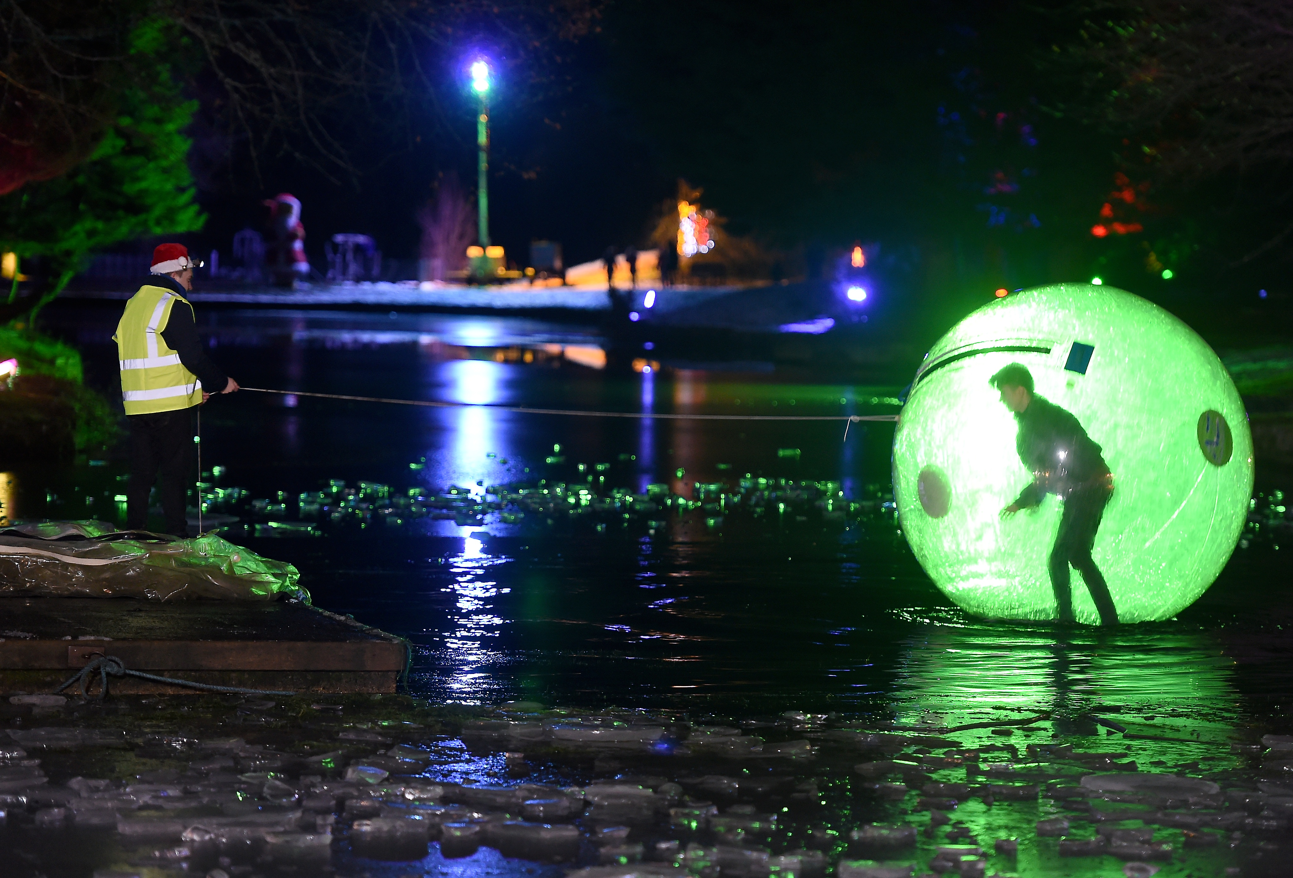 The boating lake lit up during the Winter Wonderland at Whin Park, in Inverness. Photograph by Sandy McCook