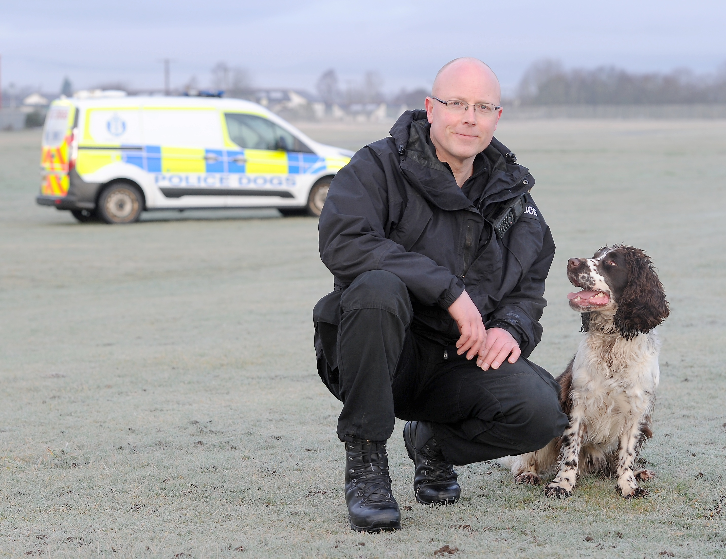Constable Donald Pearson with his specialist dog, 'Corrie'.