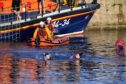 Swimmers brave the almost tropical six degree temperature in the Fraserburgh RNLI Boxing Day Swim
