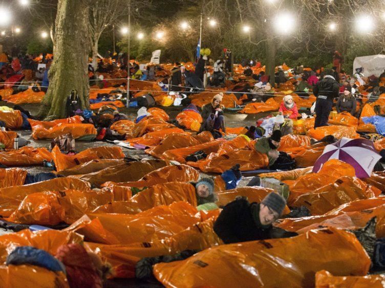 People taking part in Sleep in the Park in Princes Street Gardens in Edinburgh in December 2017