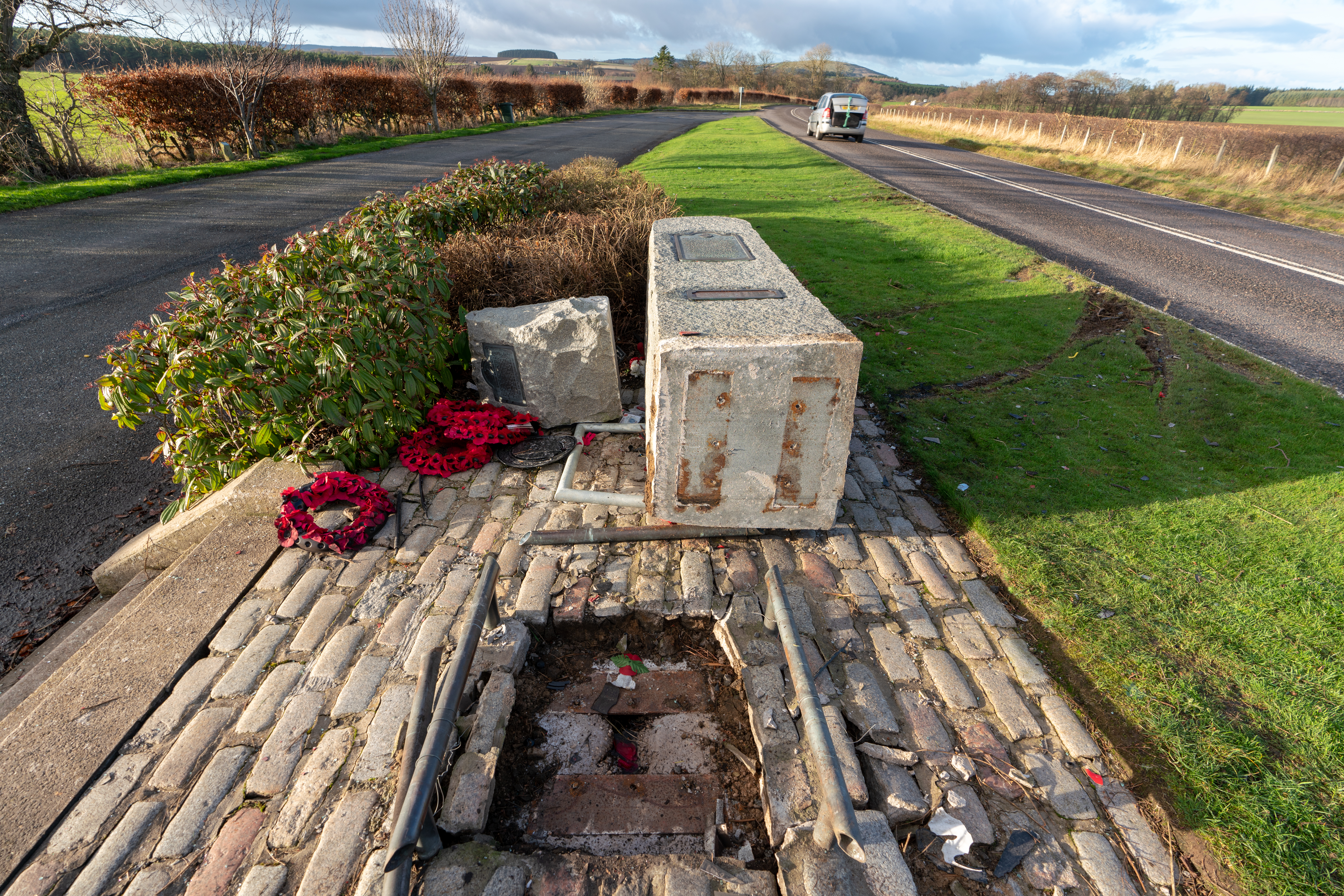 This is a picture from the scene of the WW11 RAF Banff Strike Wing Memorial at Boyndie, between Portsoy and Banff on a lay by at the A98 in Aberdeenshire, Scotland. The Monument has been hit by a vehicle at speed, knocking it from iots mounting and making t turn in 90 deg. It would appear to have been hit by a Red coloured vehicle. Photographed by JASPERIMAGE ©.