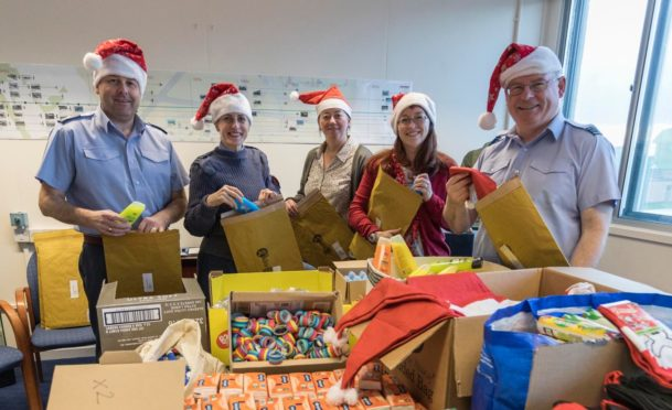 Personnel at RAF Lossiemouth assemble the parcels.