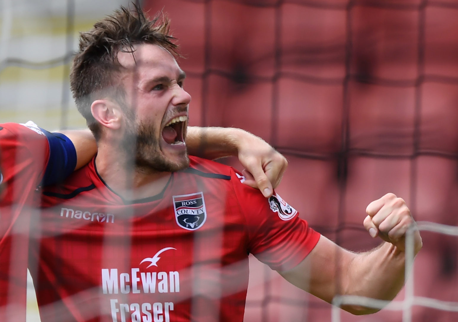 Keith Watson scored the winner in stoppage-time for Ross County.
