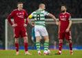 Graeme Shinnie and Lewis Ferguson with Celtic skipper Scott Brown.