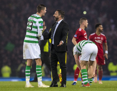 Aberdeen manager Derek McInnes speaks with Celtic's Mikael Lustig after the Betfred Cup final.