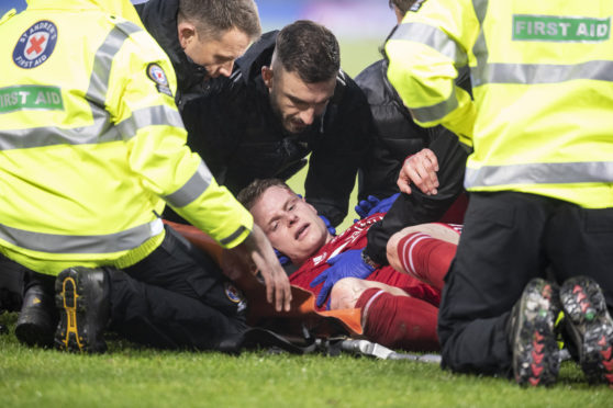 Gary Mackay-Steven receives treatment after suffering a nasty head injury