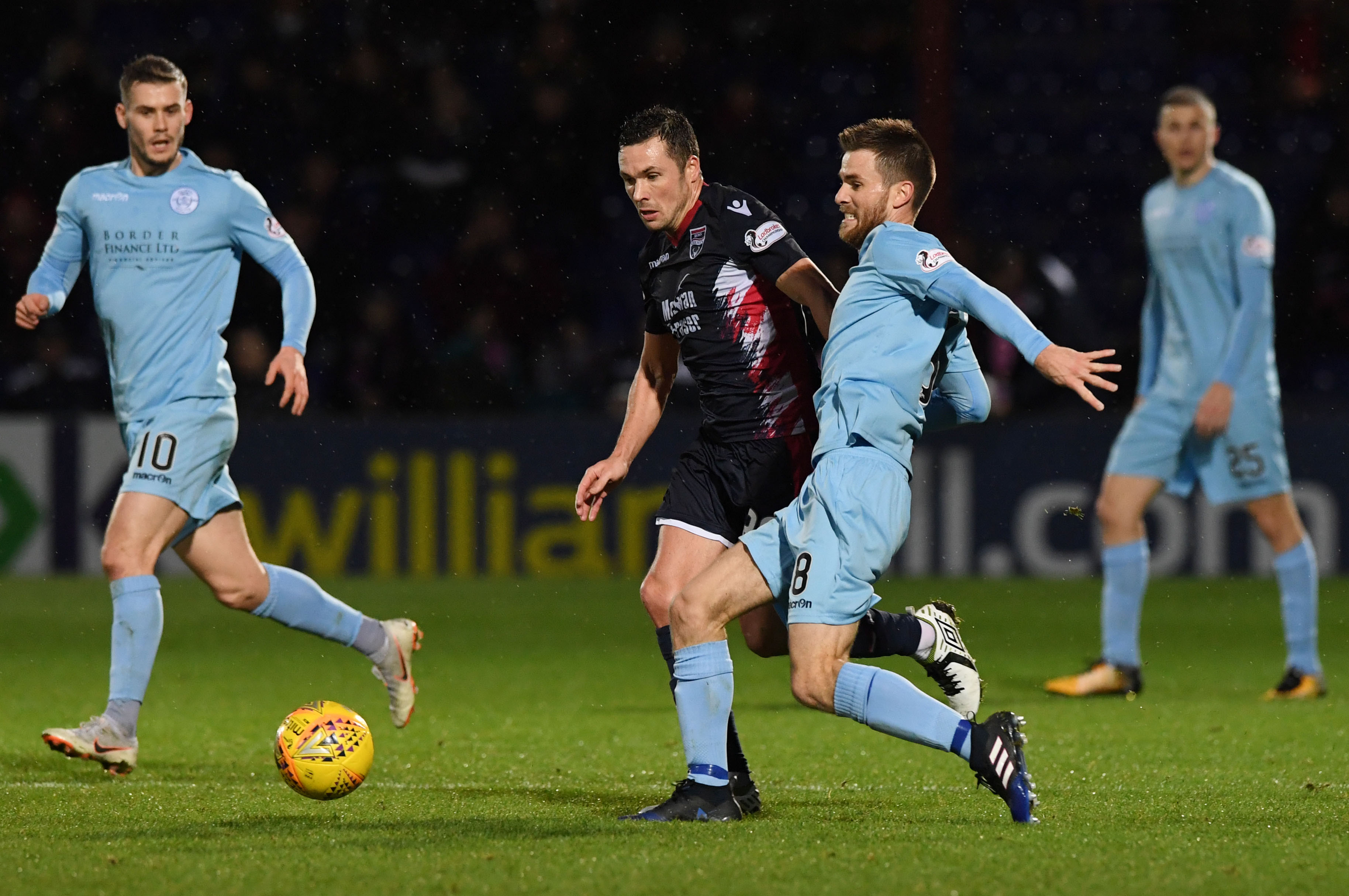 08/12/18 LADBROKES CHAMPIONSHIP ROSS COUNTY V QUEEN OF THE SOUTH (1-1) GLOBAL ENERGY STADIUM - DINGWALL Ross County's Don Cowie (L) and Queen of the South's Kyle Jacobs compete for the ball