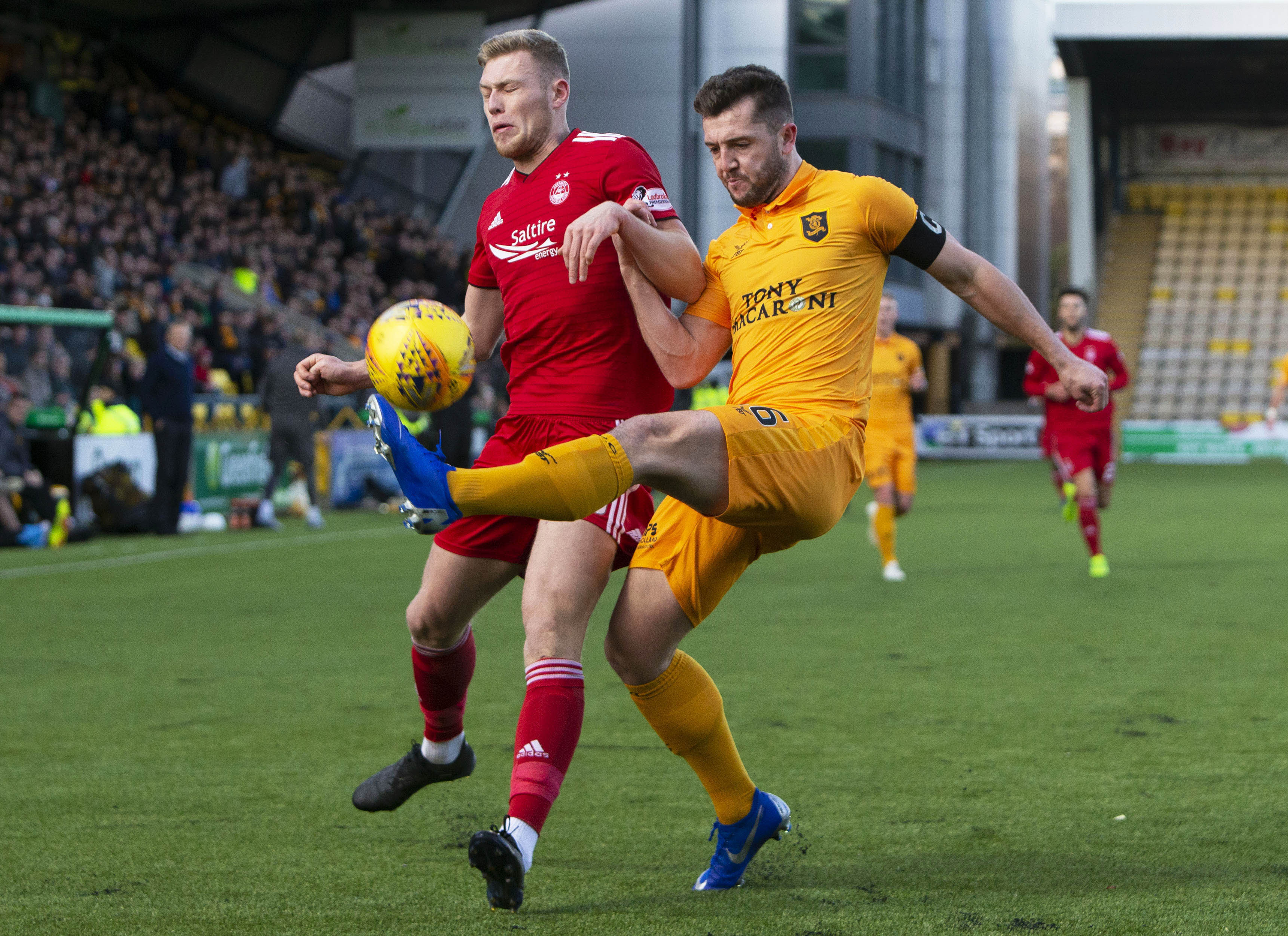 Livingston's Craig Halkett (R) defends from the oncoming Sam Cosgrove