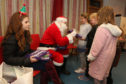 Santa had a gift for every child in Kiltarlity on Saturday