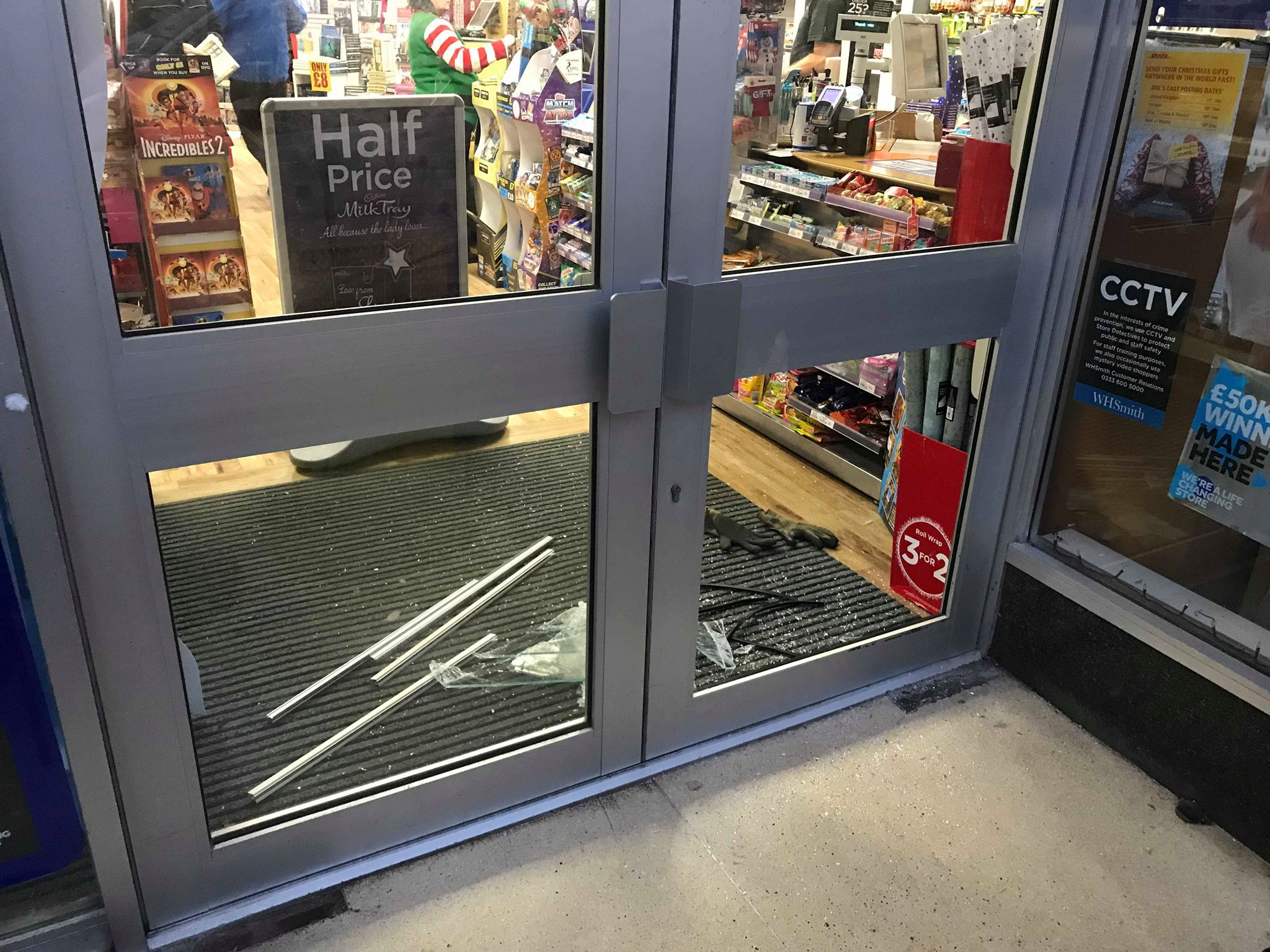 The smashed door panel at WH Smith, Marischal Street, Peterhead
