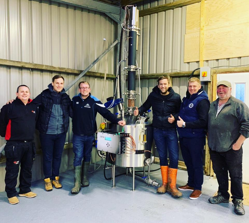 Ian Smith, centre left, who left Tiree to study seven years ago, but now plans to return to the island. He has set up a company producing gin that will help to employ himself and others.