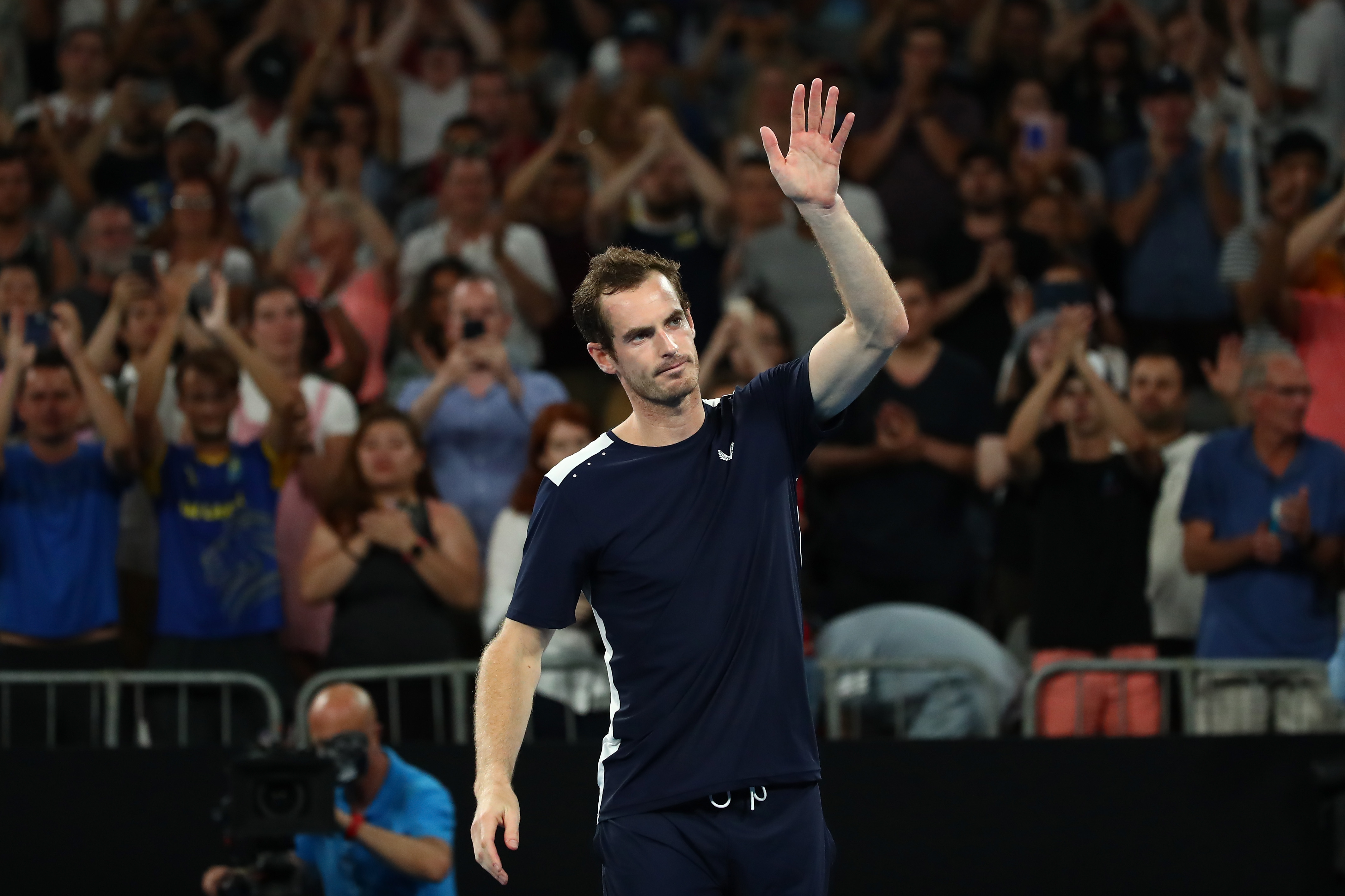 Andy Murray thanks the crowd after losing his first round match against Roberto Bautista Agut.