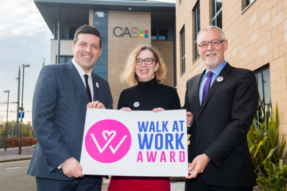 Jamie Hepburn MSP, Ian Findlay of Paths for All and Lesley Glen, ICAS's chief operating officer as the Walk at Work Award is launched in Shetland