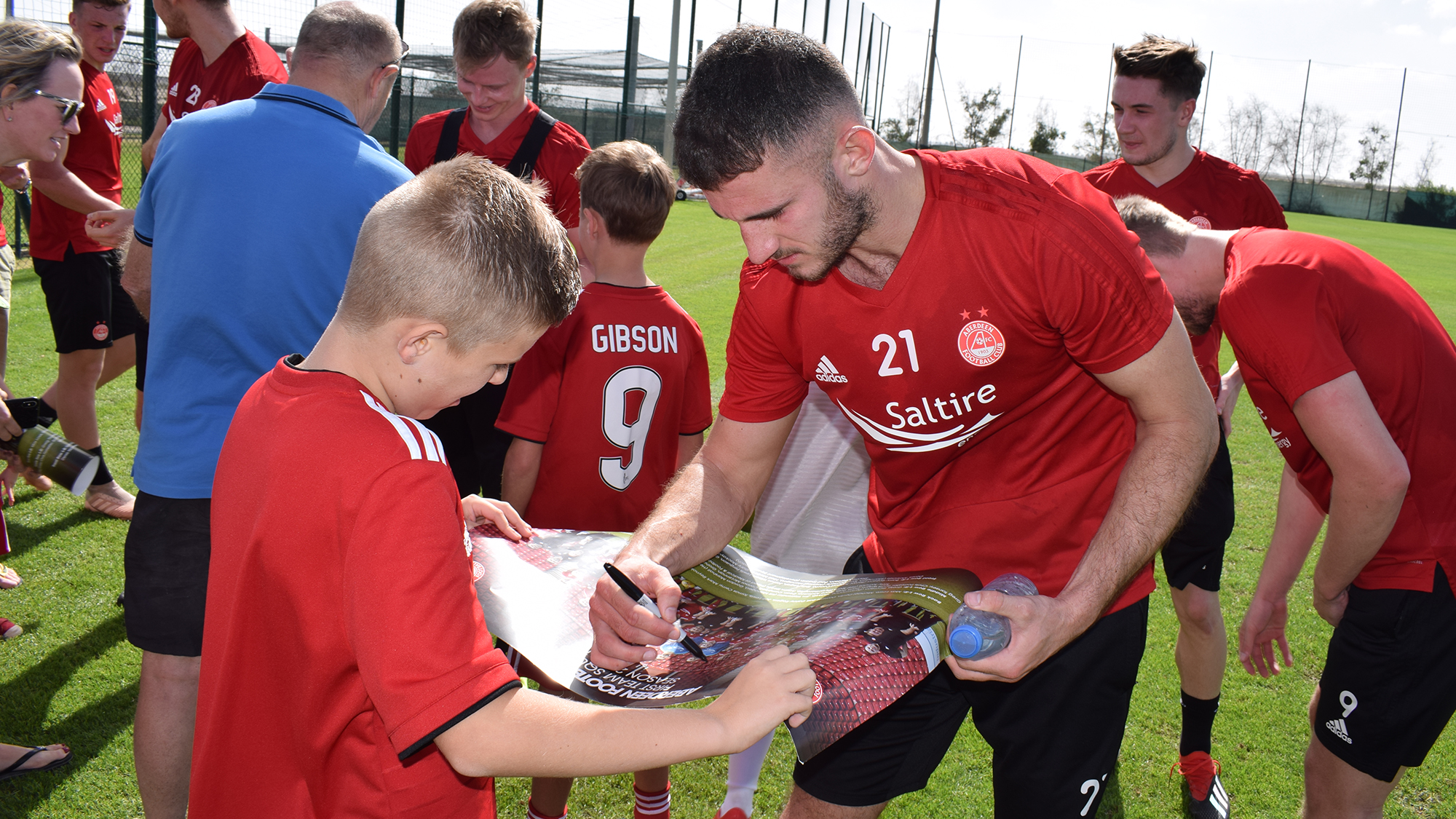Dominic Ball signs autographs for fans at yesterday's open training session. Picture: AFC Media.