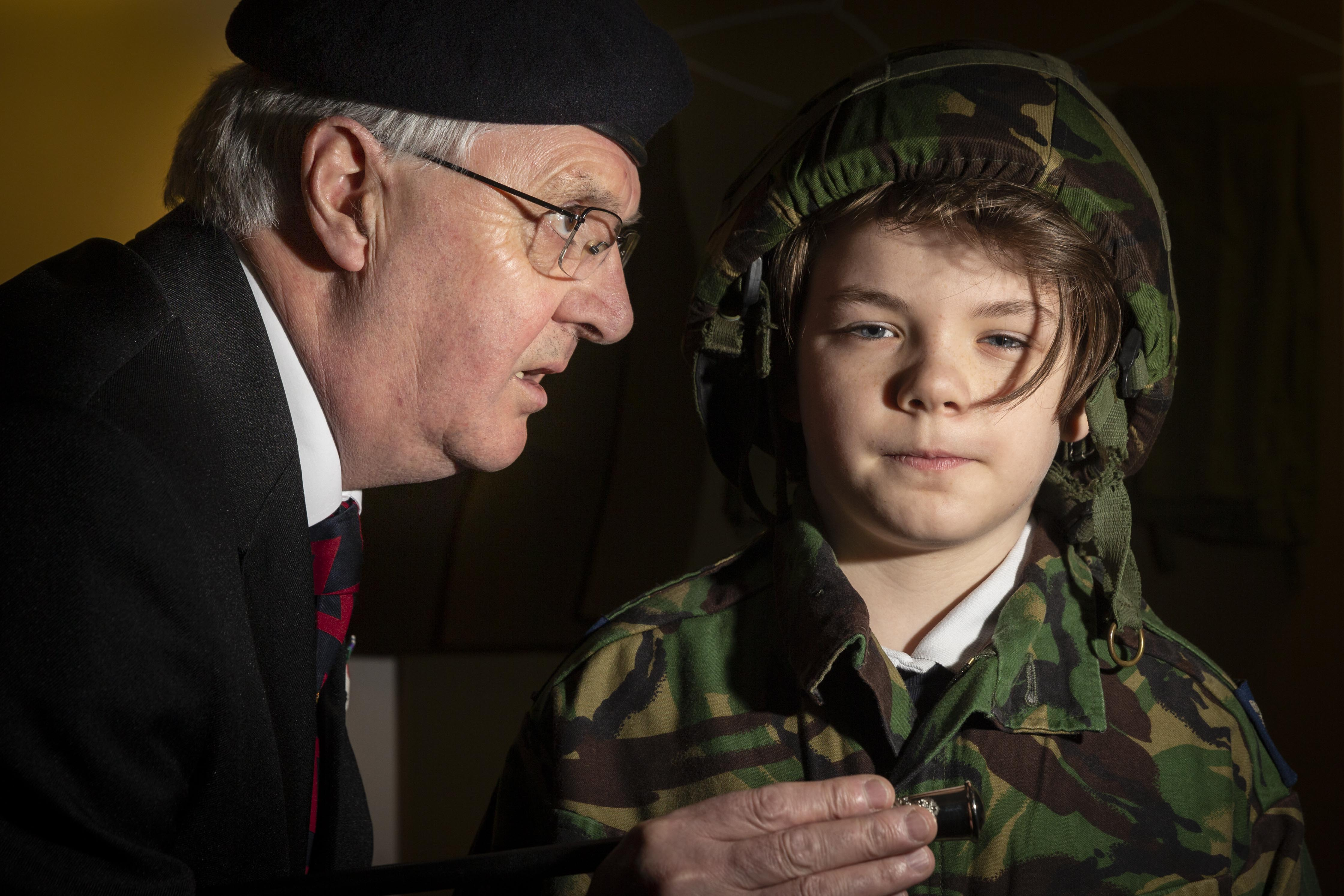 A P7 pupil from Banchory primary school gets put through his paces by a Banchory British Legion member and veteran during a WW2 lesson in Banchory's museum.