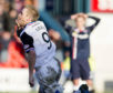 ICT's Richie Foran clutches his face in celebration of his goal scored with the same part of his body.