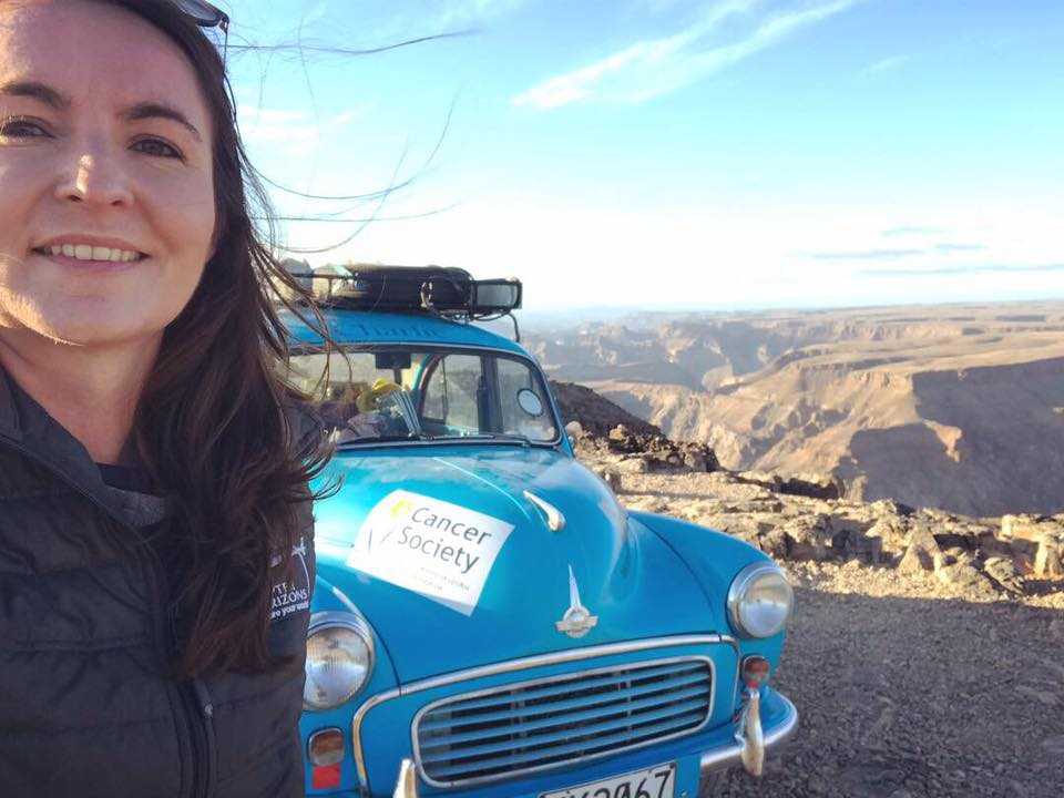 Laura Morrison with her blue Morris Minor at Fish River Cayon in Namibia.