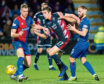 Caley Thistle's Sean Welsh (right) battles with Ross County's Ross Stewart.